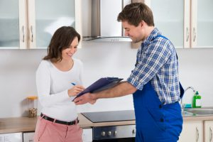 Plumber and Customer in Kitchen